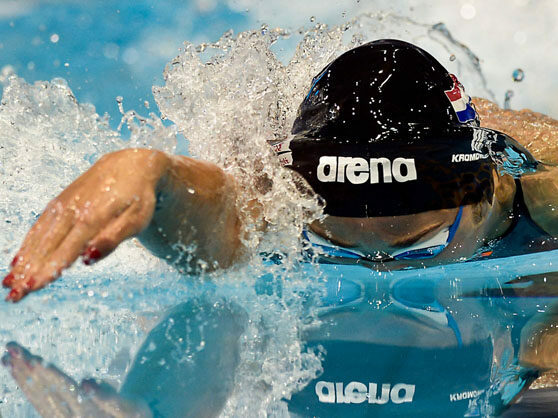 Freestyle hand entry: swimmer in an Arena swim cap doing a freestyle swim