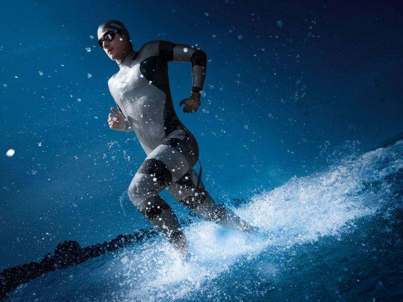 A swimmer running through shallow water