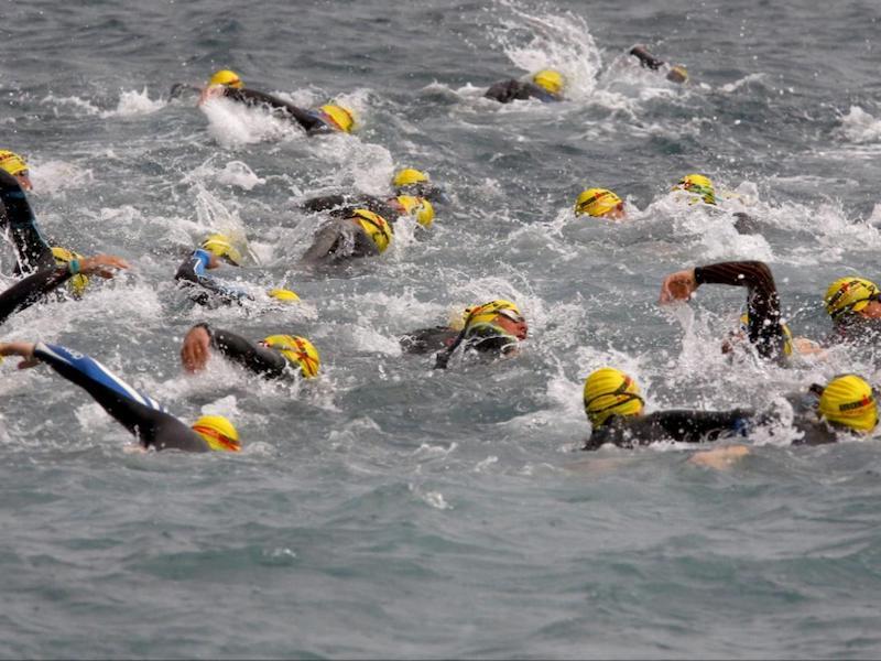 Triathlon goggles: people swimming in the sea