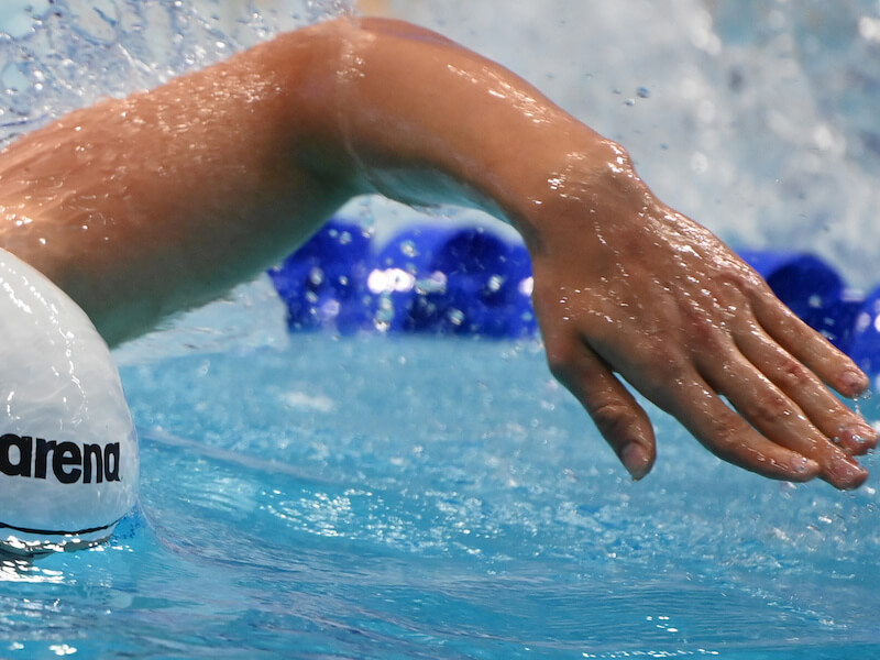 Freestyle pull: close-up shot of a swimmer's arm doing a freestyle stroke